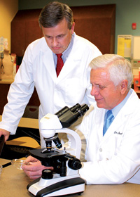 Two doctors at the microscope